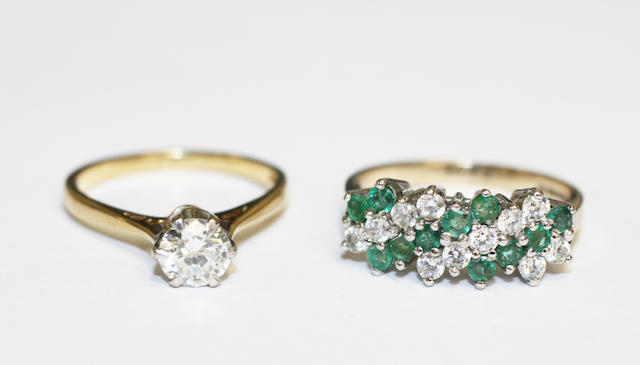 A diamond single stone ring and an emerald and white stone half hoop ring, (2)