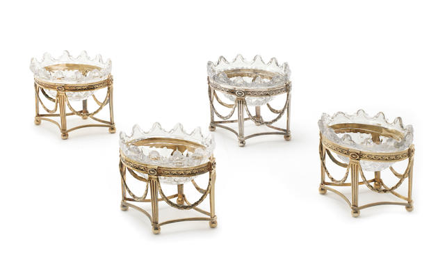 A set of four George III silver-gilt and silver sweetmeat or salt dishes/stands by Pitts and Preedy, London 1791  (4)