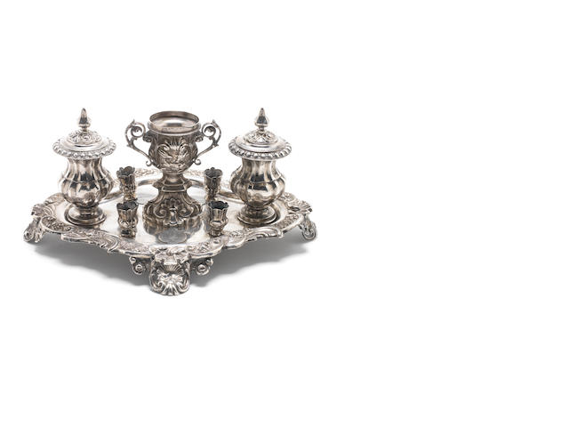 An early 19th century Italian silver inkstand Milan, 1810-15,  makers mark unidentified together with a chalic and dressing pot and cover  (3)