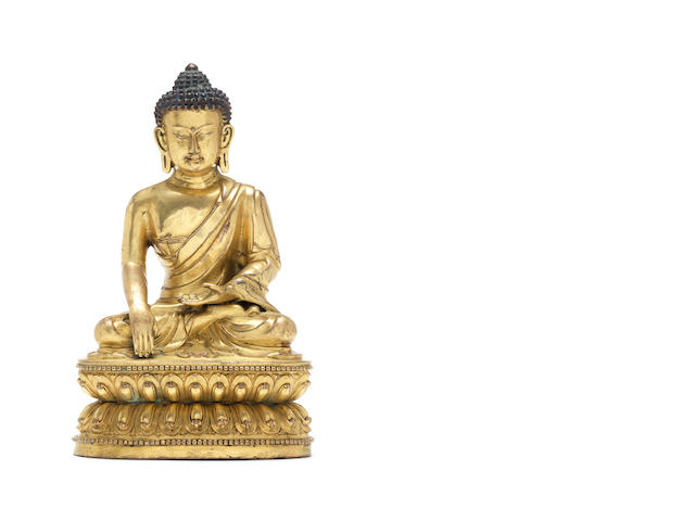A gilt-bronze figure of a seated Buddha 16th century