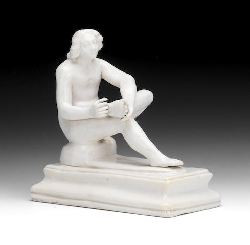 A saltglaze figure of Spinario