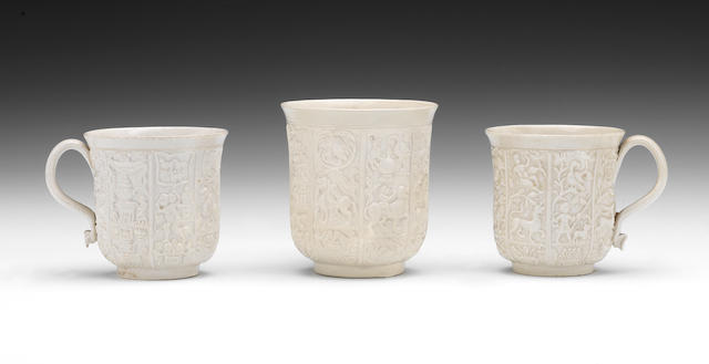 A large saltglaze cup (extensively restored), a small saltglaze cup (hairline crack to rim) and another small saltglaze cup