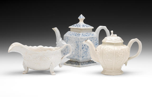A hexagonal teapot and cover (cover restored and restoration to body), a saltglaze sauceboat (restored) and a saltglaze diamond shaped teapot and cover (replacement cover and restored body)