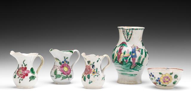 Three saltglaze cream jugs, a milk jug, and a teabowl, circa 1750-55