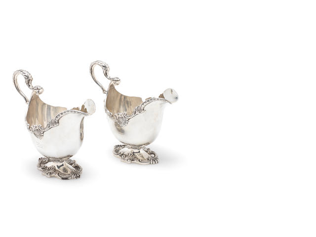 A pair of silver sauceboats, in the 18th century de Lamerie manner by Fordham & Faulkner, Sheffield 1911  (2)