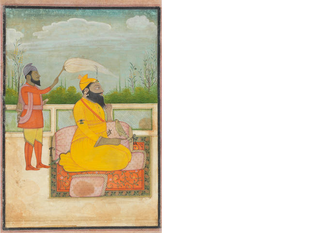 Guru Govind Singh, the tenth Sikh Guru (1675-1708), seated on a terrace with an attendant waving a gauri Pahari, circa 1830