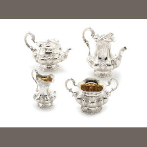 A William IV / Victorian matched four-piece silver tea and coffee service sugar bowl and jug by Thomas Whitehead, London 1833,  tea pot and coffee pot by William Theobalds & Robert Metcalf Atkinson, London 1838  (4)