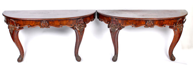 A pair of mid-Victorian mahogany 'D' end shaped console tables