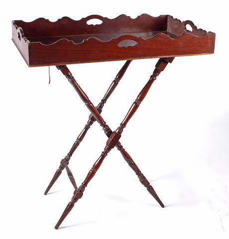 A 19th Century mahogany butler's tray on folding stand