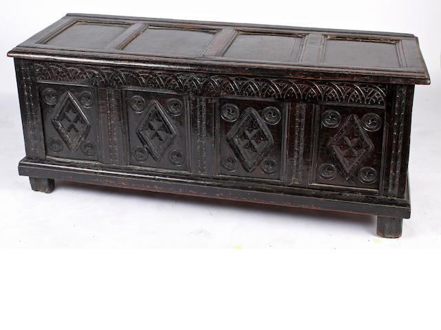 A panelled oak coffer,