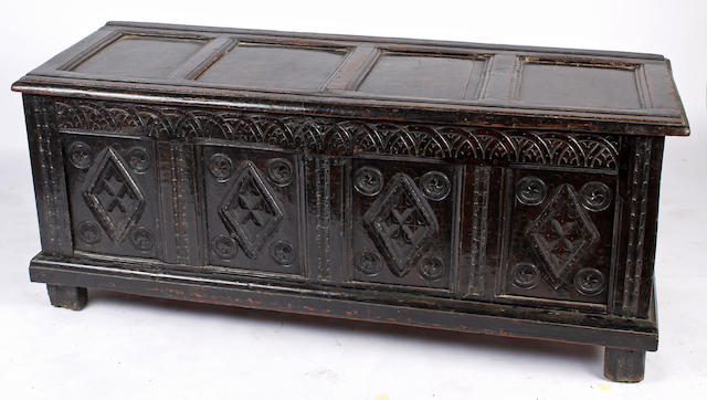 A panelled oak coffer,