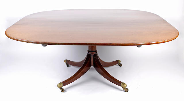 A late George III mahogany pedestal dining table