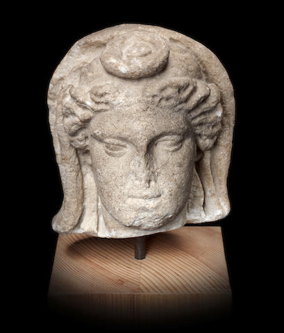 A Roman marble head of a goddess