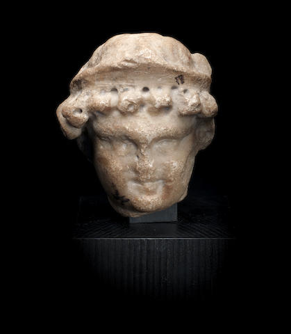 A Roman marble herm head of Eros