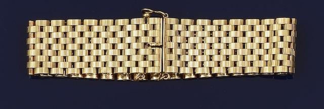 A 9ct gold broad bracelet