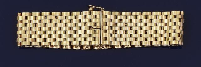 A 9ct gold broad bracelet