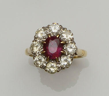 A ruby and diamond cluster ring and a cameo ring (2)