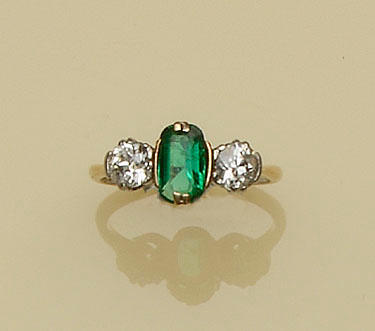 An early 20th century emerald and diamond three stone ring