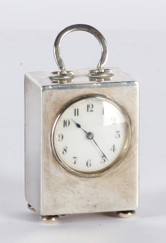 A silver cased small carriage type clock