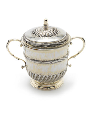 A William III silver gilt porringer and cover by John Ruslen, London 1700