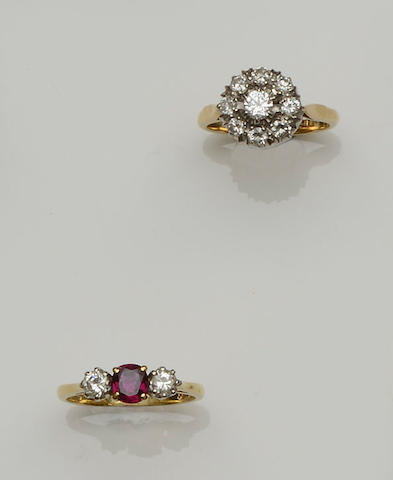 A diamond cluster ring and a ruby and diamond three stone ring