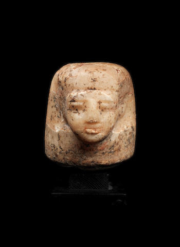 An Egyptian alabaster canopic jar stopper