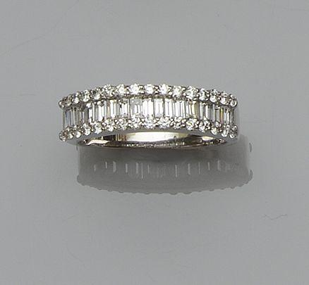 An 18ct white gold diamond half eternity ring