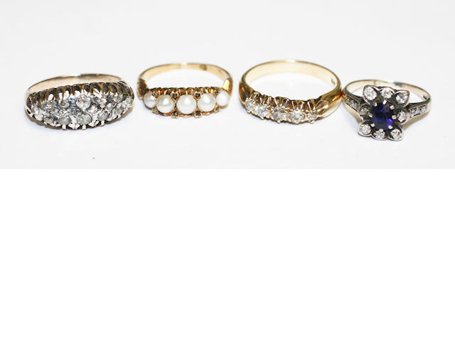 Four gem set rings,