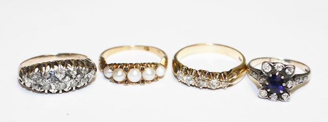 Four gem set rings,