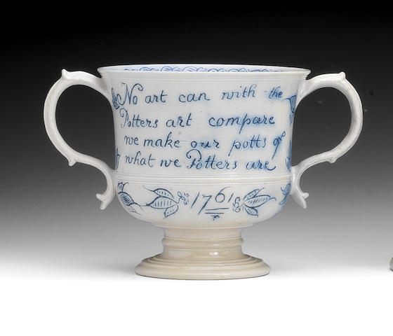 A saltglaze double handled loving cup, dated 1761 (extensively restored)