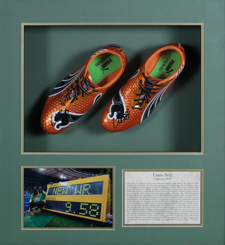 Usain Bolt: A pair of framed autographed running spikes,