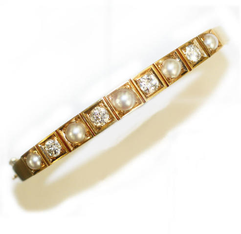 A Victorian gold diamond and half pearl set hinged bangle
