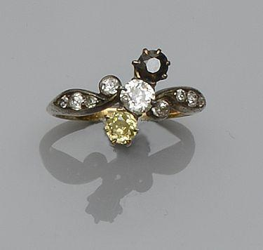 A yellow and white diamond set dress ring