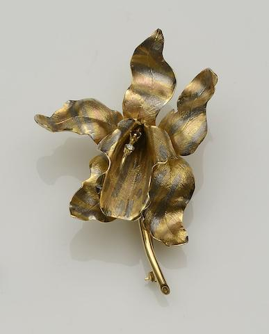 A ruby and diamond set orchid brooch