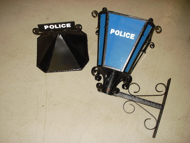 A 'Police' station sign,