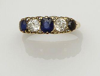 An 18ct gold sapphire and diamond five stone ring