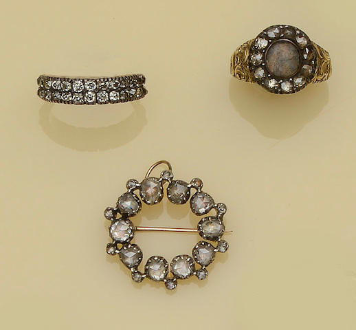 Two diamond set rings and a rose-cut diamond brooch
