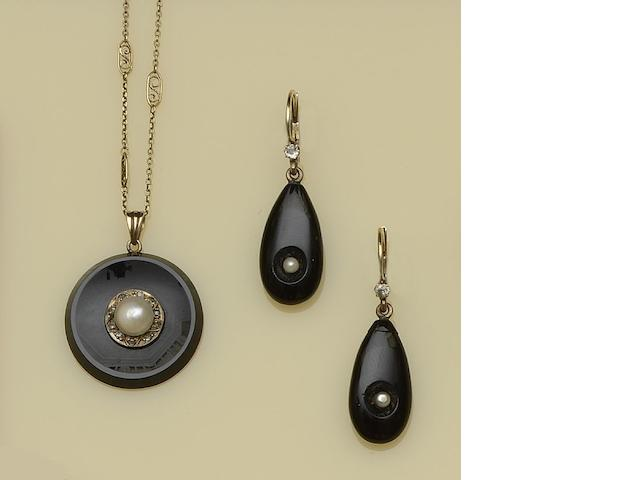 An onyx, pearl and diamond pendant and matching earpendants