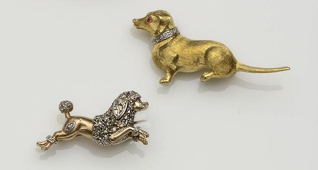 Two diamond set dog brooches (2)