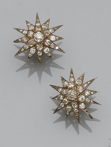 A pair of Victorian diamond set star burst pendants/earrings