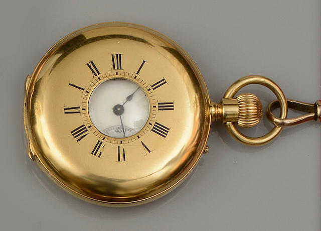 Racine: An 18ct gold half hunter pocket watch on a long 9ct gold Albert chain