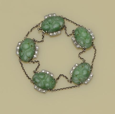 An Art Deco jade and diamond bracelet and ring (2)