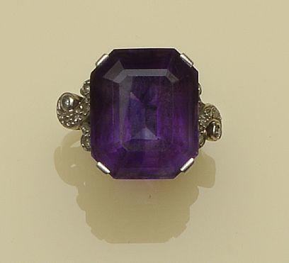 Four gem set rings  Comprising a five stone emerald ring, a large step-cut amethyst cocktail ring, with scrolled diamond set shoulders, a three stone diamond crossover ring, and a pale yellow topaz ring, with diamond set shoulders. (4)