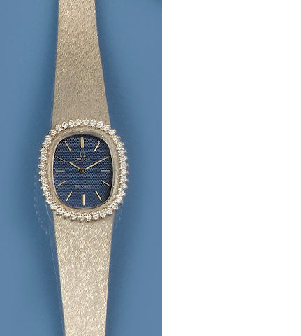 Omega: A diamond and white gold lady's wristwatch