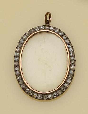 An oval diamond set pendant