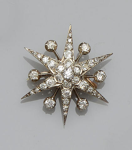 A diamond star brooch/pendant
