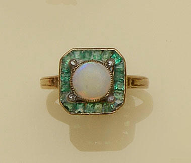 An opal, emerald and diamond panel ring