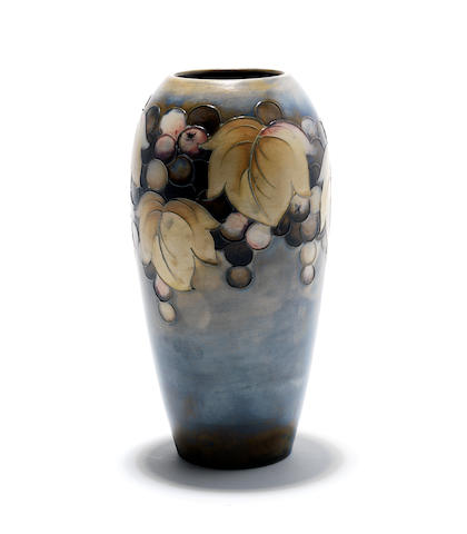 A Walter Moorcroft 'Leaf and Berry' salt glaze vase