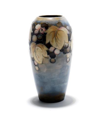 A Walter Moorcroft 'Leaf and Berry' salt glaze vase