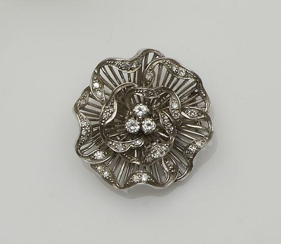 A diamond set flower brooch